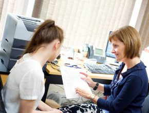 A clinician explaining test results to a patient