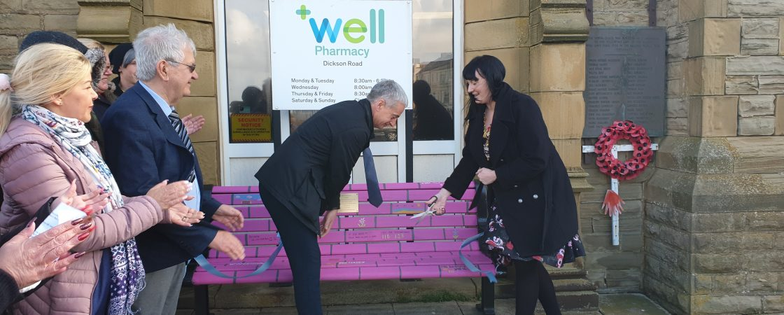 picture of Mayor of Blackpool officially opening the chatty bench (a bright pink bench)