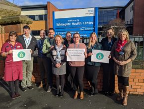 Staff from the urgent care centre standing in front of Whitegate Drive Health Centre