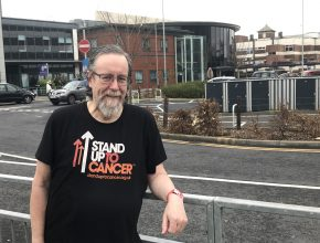 Steve Tingle wearing Stand Up To Cancer T-shirt outside Blackpool Victoria Hospital