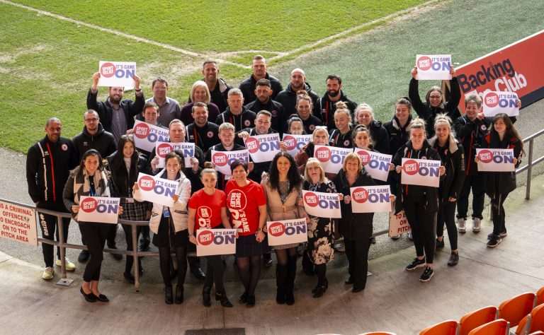 Staff from Fylde Coast CCGs and Blackpool FC Community Trust showing their support for Sport Relief