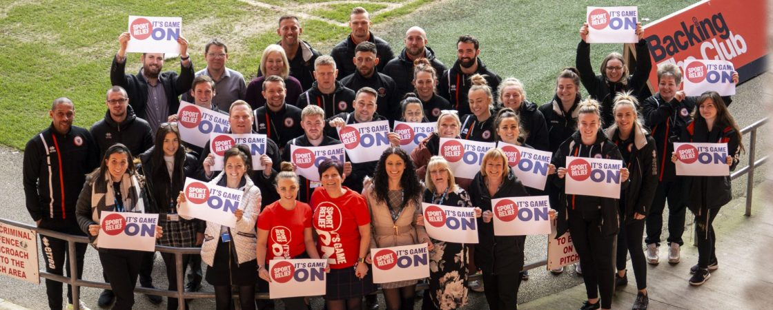 CCG staff grouped with Blackpool Community Foundation Trust staff from above to promote Sport Relief sponsored walk