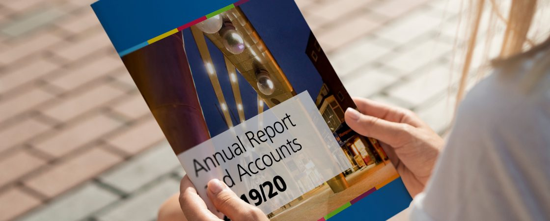 Young woman holding a copy of Blackpool CCG's annual report