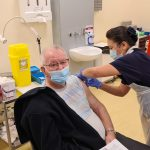 picture of Brian Marshall, 87, having his vaccination