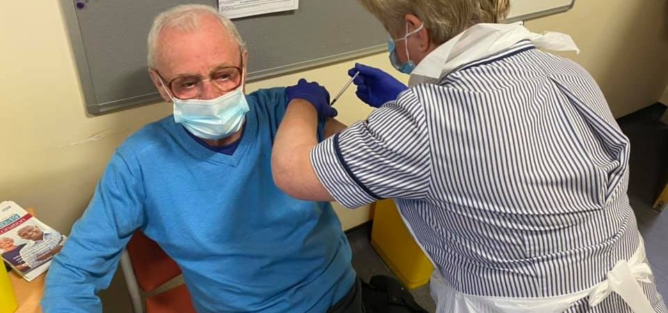 Man receiving COVID-19 vaccination injection