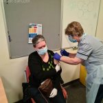 Marjolein Van Dijkhuizn, a care home member of staff havine her vaccination at South Shore PCN