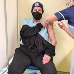 Picture of Mr Peter Begg from the Central West PCN having the vaccination